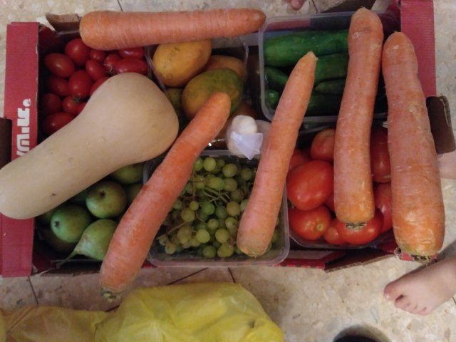 "This ""surprise box"" from Tachlit included potatoes, onions,carrots, garlic, cucumbers, plum tomatoes, cherry tomatoes, pears, grapes, mangoes, and a butternut squash, all for only 40 shekels (under 11 dollars)!"